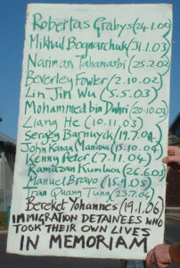 Placard detailing the names of those that have died in immigration detention