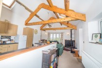 Open plan living with exposed beams.