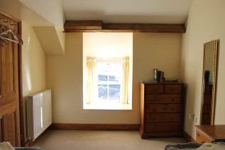 View of the window in the first floor front bedroom. Low window seat.