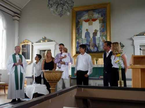 Bishop Fredrik, Ben, Susanna, Chuck & Izzy, Will, godparents Niklas and Sofia at the christening.