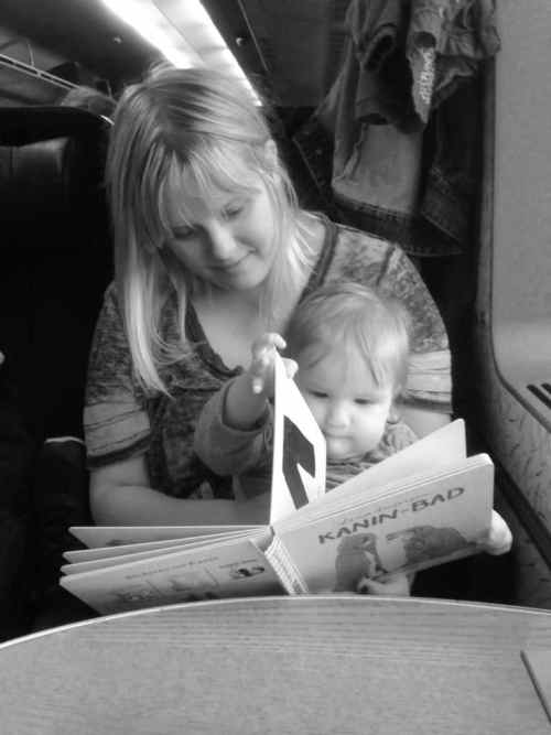 On the train from Växjö, Sweden to  Københavns Lufthavn (Kastrup Airport). Reading a book with Mom.