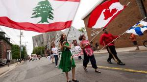 People from Halifax's Lebanese community participate in the Multifest Parade in 2010. The support system built up around the family and church by Lebanese immigrants is credited for creating a strong, closely knit community.