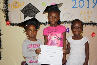 Group of girls with their certificate of completion