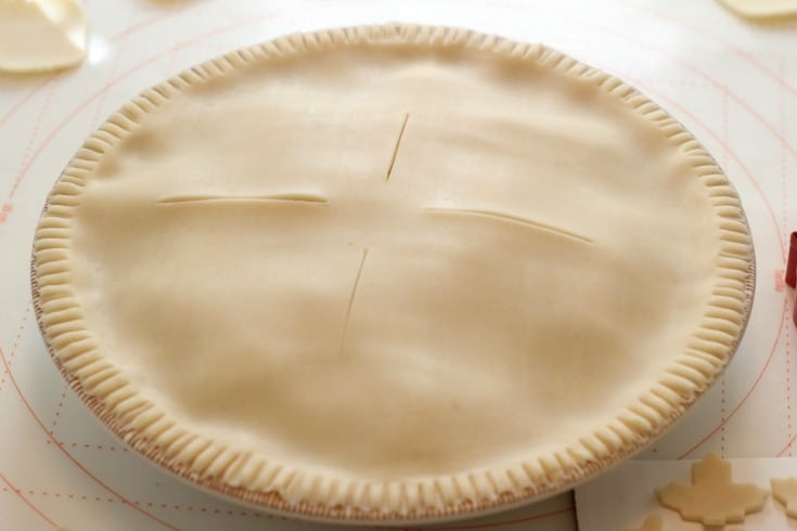 Adding the top crust to the apple pie