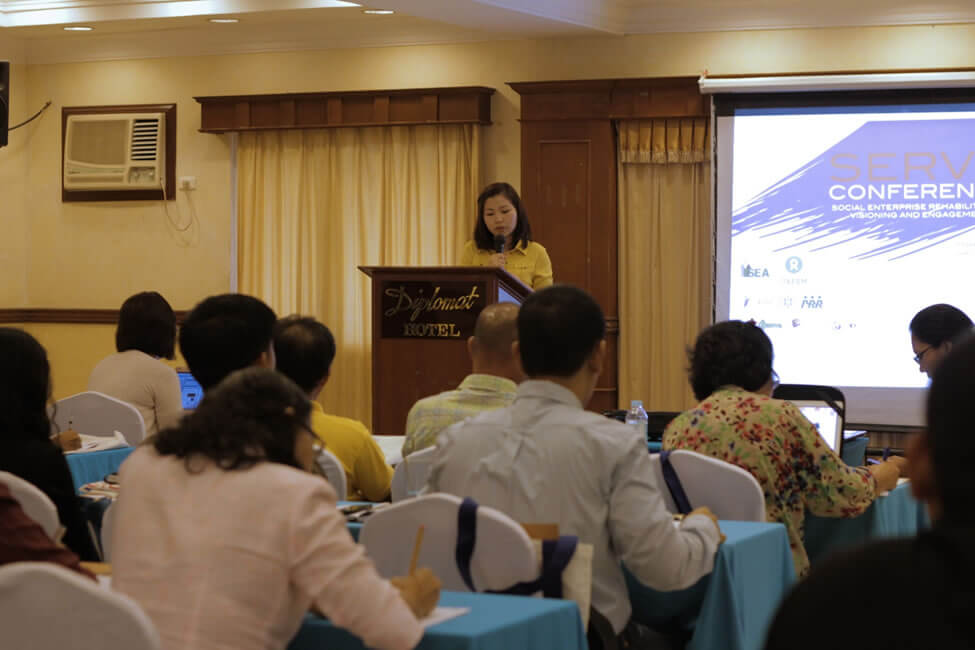Ms. Precious Namoc, National Coordinator of Philippine Coffee Alliance, serves as emcee during the Opening Program on March 13, 2014
