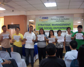 Alter Trade Group manager-participants present their social marketing workshop output to the plenary.