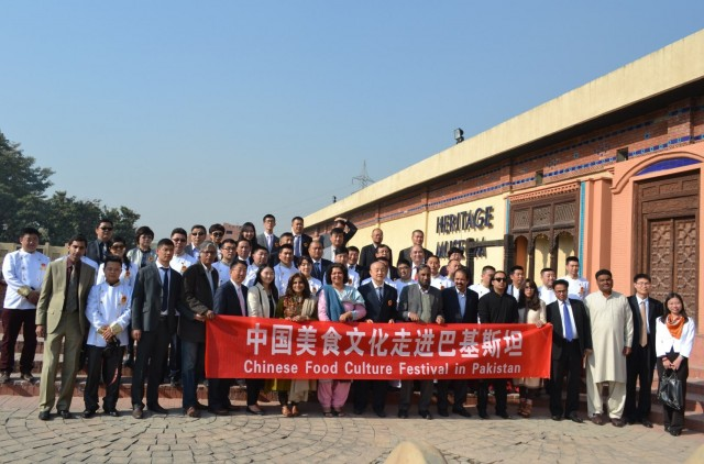 Group photo of Chinese delegation with Pakistani officials at Lok Virsa in Islamabad.