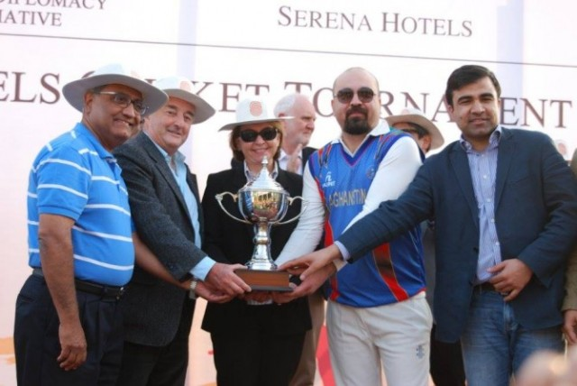 Posing with the Trophy at two-day sporting event in Islamabad.