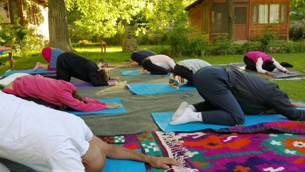 Yoga session in progress by Pakistani instructor, Aisha Chapra, in beautiful Chitral.