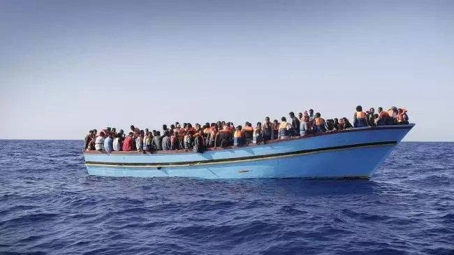 Another boatload of immigrants from Africa hoping to get to Italy in this flimsy craft