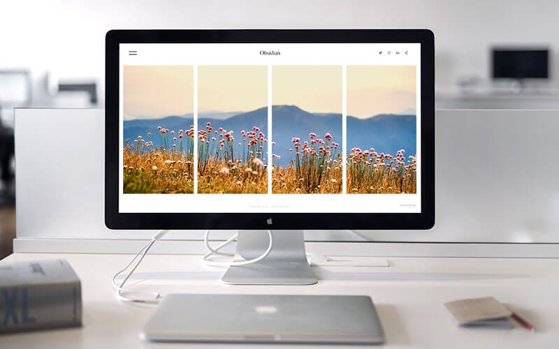 An Apple Mac Computer With Web Design