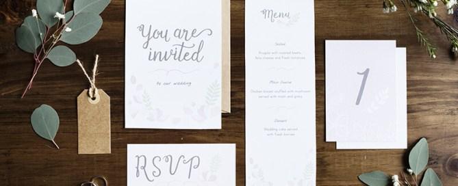 Wedding Invitations On A Table
