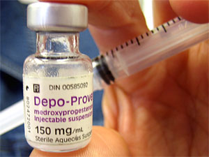 Close-up of Depo-Provera (contraceptive injection) vial and syringe
