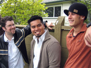 three young men standing by a fence talking about crabs and scabies