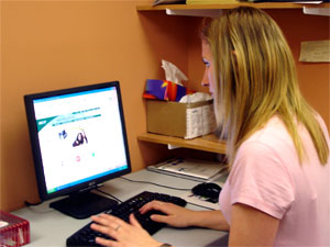 woman sitting at the computer looking for information on sexual health