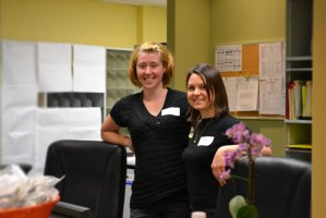Heather and Sofie standing in our new front desk of the sexual health clinic