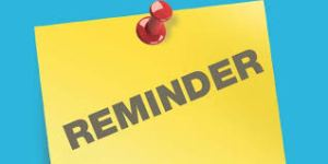 """a yellow notice tacked to a bulletin board that says """"reminder"""""""