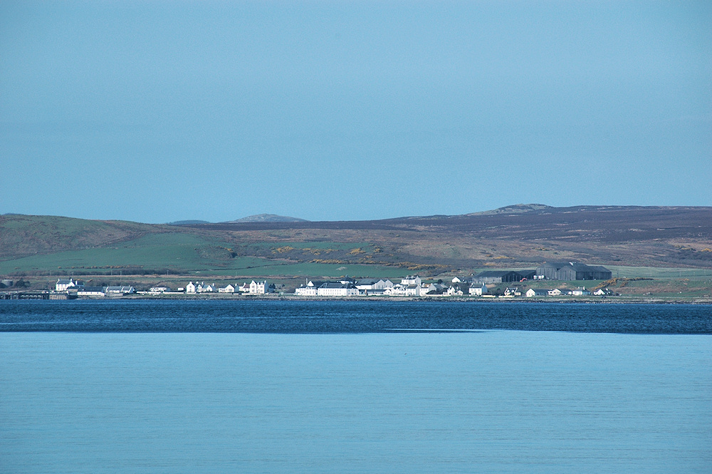 Picture of the village of Bruichladdich, seen across Loch Indaal, a sea loch on Islay