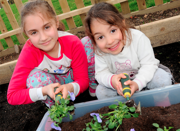Green fingers: some young gardeners pitched in to help this year's Islington in Bloom competition to flower, at the launch event. Photographs: Islington Council