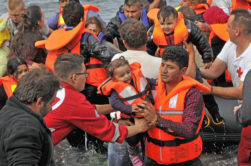 Syrian refugees landing in Greece. Photo via www.shutterstock.com