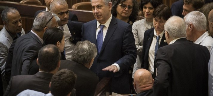 Prime Minister Benjamin Netanyahu surrounded by Knesset members after a vote on the state budget for 2015-2016, November 18, 2015.