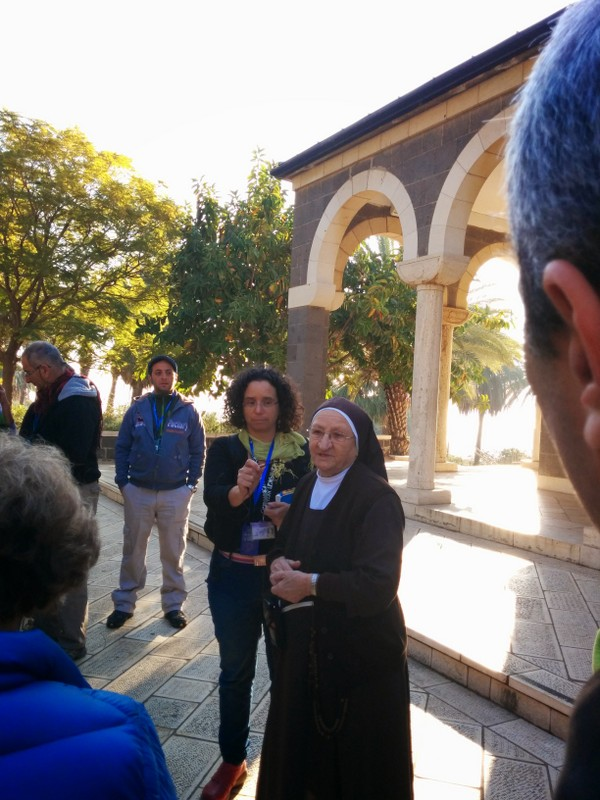 Sister explaining rules of dress and behavior in the Church of the Beatitudes
