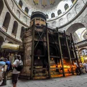 The Aedicule in Israeli Church of the Holy Sepulchre with the Armenian chapel to the left with golden roof; the main entrance is to the right. Photo: Jlascar