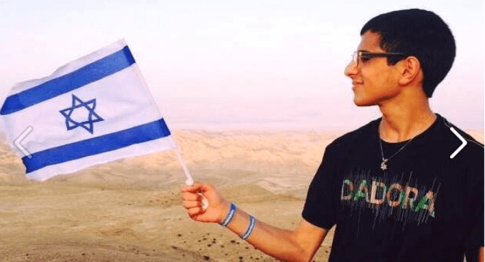 Mohammad Zoabi holding the Israeli flag - non-Jews can be Zionists