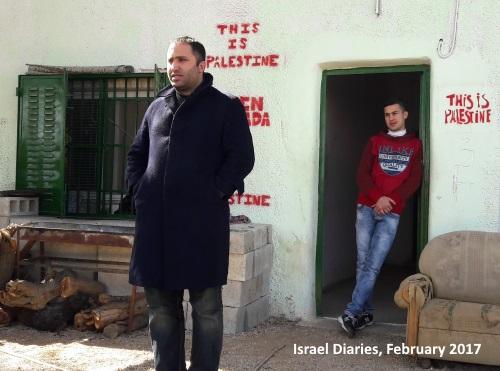 Issa Amro talking to group