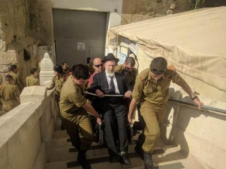 being carried up the stairs at the Cave of the Patriarchs
