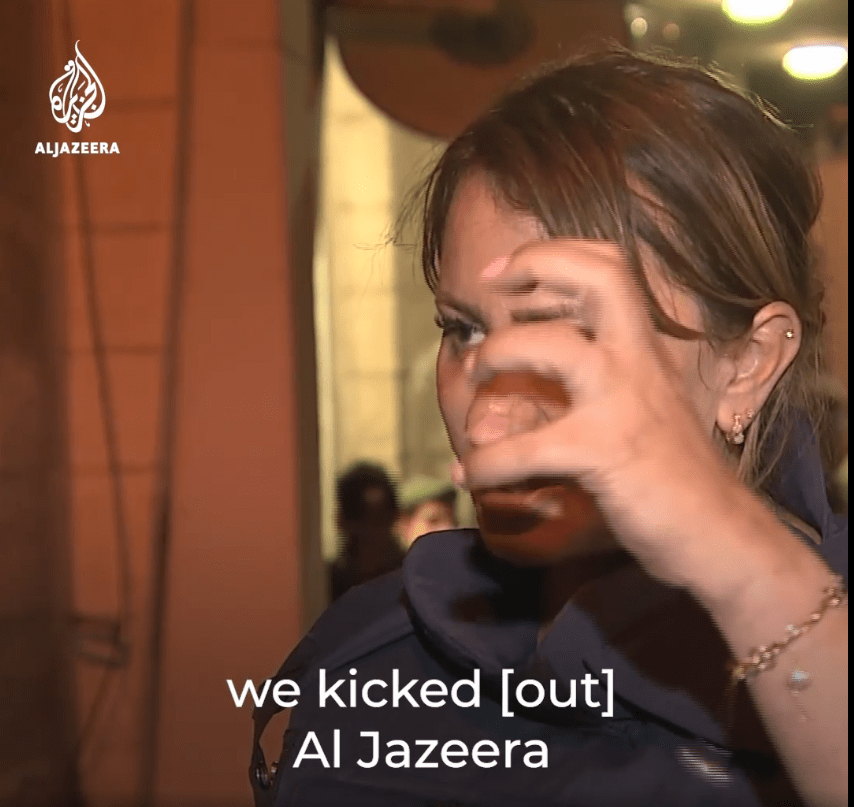 """moments after her release she is shown using her """"broken"""" arm on an Al-Jazeera interview"""