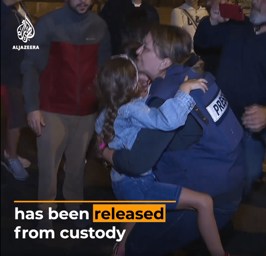 """Givara Albudeiri photo from video of her release on Al-Jazeera showing holding child with """"broken"""" arm"""