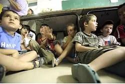 Children in bomb shelter (illustrative)