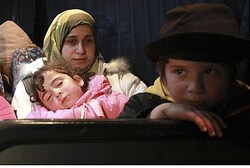 Syrian refugees rest in Jordanian army bus