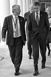 President Barack Obama walks along the Colonnade with John Holdren