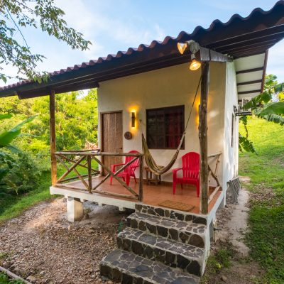 Enjoy Peaceful Simplicity and Comfort in our Jungle Cabins, steps away from a tropical beach.