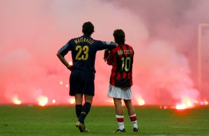 Inter Milan's Materazzi and Rui Costa of AC Milan wait on the pitch during their Champions League soccer match in Milan