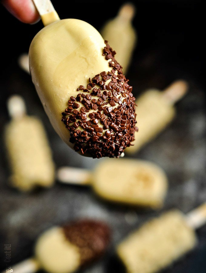 Hazelnut Milk Triple Chocolate Popsicles are a decadent blend of hazelnut milk, cocoa, dark and blond chocolate, dipped in praline and chocolate flakes.