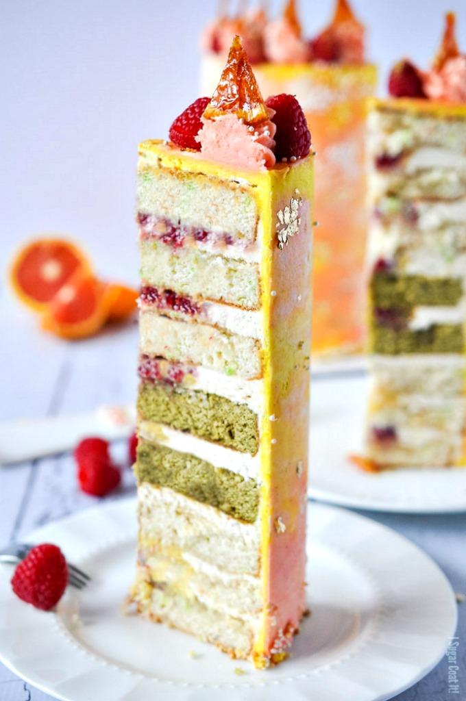 Cara Cara Coconut Matcha Cake boasts eight layers of coconut and matcha cake filled with cara cara orange curd, fresh berries and silky citrus buttercream!