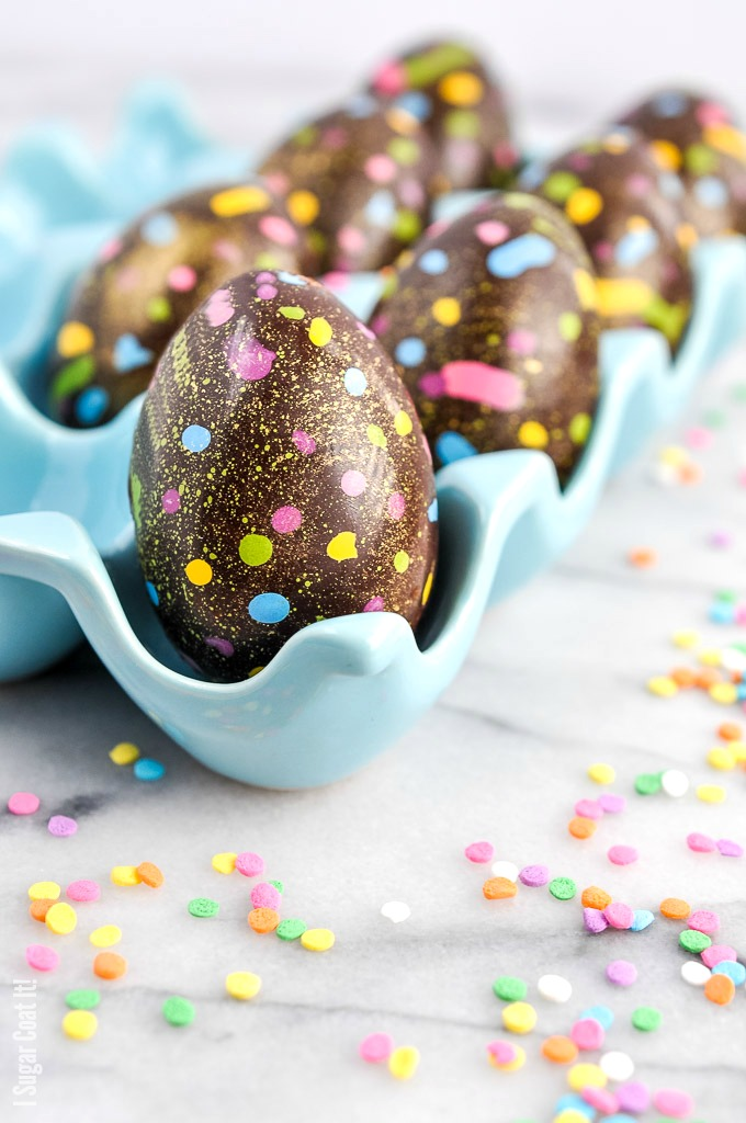 These Salted Caramel Cream Easter Eggs are play on the popular Cadbury eggs, but with a decorated dark chocolate shell and a fondant, salted caramel centre.