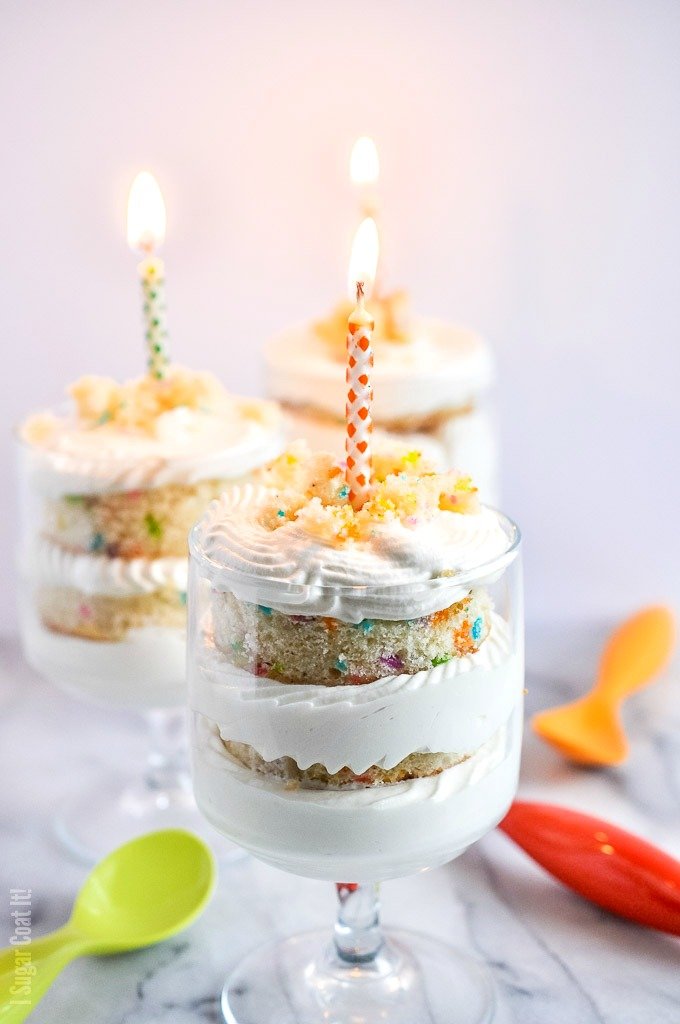 Funfetti White Chocolate Mousse Trifle are layers of funfetti vanilla cake, pineapple curd and an easy 2-ingredient white chocolate mousse, stacked in single-serve sized trifles.