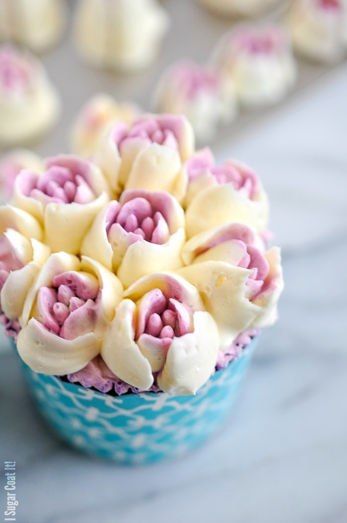 Blueberry Lemon Cupcakes topped with decadent blueberry lemon buttercream flowers, deliver fresh, tangy sweetness in every bite!