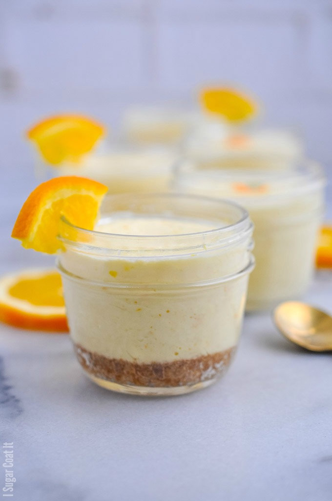 Single-serve jars of ginger cookie base and velvety, light-as-airSous Vide Orange Mascarpone Cheesecake made with #TrestelleCheese.