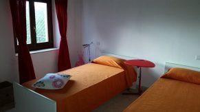 Appartement Iperirco | Slaapkamer 2 met twee 1-persoonsbedden