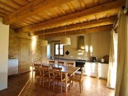Vakantiehuis Vin Cotto | Woonkamer met open keuken