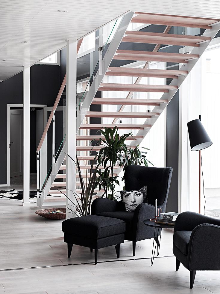 finnish home interior, finland home decor, wall gallery, black wall decor, reading corner idea, fornasetti cushion