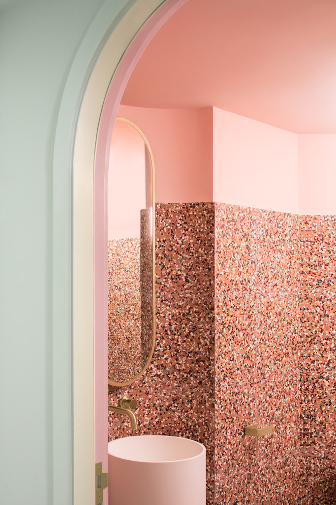 cafe design in china, the budapest cafe, pastel colors interior, wes anderson design, pink toilet design