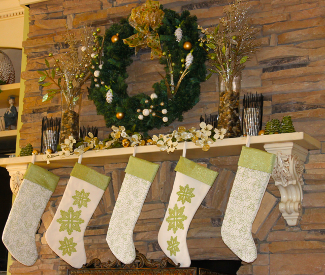 A Woodland-themed Green, Cream, and Brown Fireplace Mantel, with a touch of gold-kissed Dogwood blossoms for a Southern touch!
