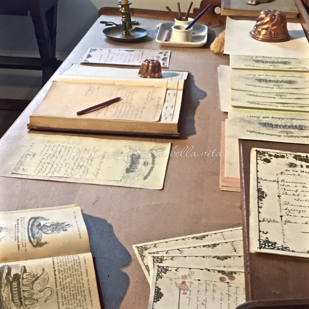 The kitchen desk with notes and cookbooks from the royal chef of the king.