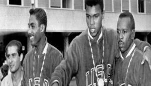 FILE - In this Sept. 6, 1960, file photo, U.S. boxers, from left, Wilbert McClure of Toledo, Ohio, light middleweight; Cassius Clay (Muhammad Ali), and light heavyweight; and Edward Crook of Fort Campbell, Ky, middleweight, wear gold medals at the Olympic village in Rome. Ali, the magnificent heavyweight champion whose fast fists and irrepressible personality transcended sports and captivated the world, has died according to a statement released by his family Friday, June 3, 2016. He was 74. (ANSA/AP Photo/File) [CopyrightNotice: Copyright 2016 The Associated Press. All rights reserved. This material may not be published, broadcast, rewritten or redistribu]